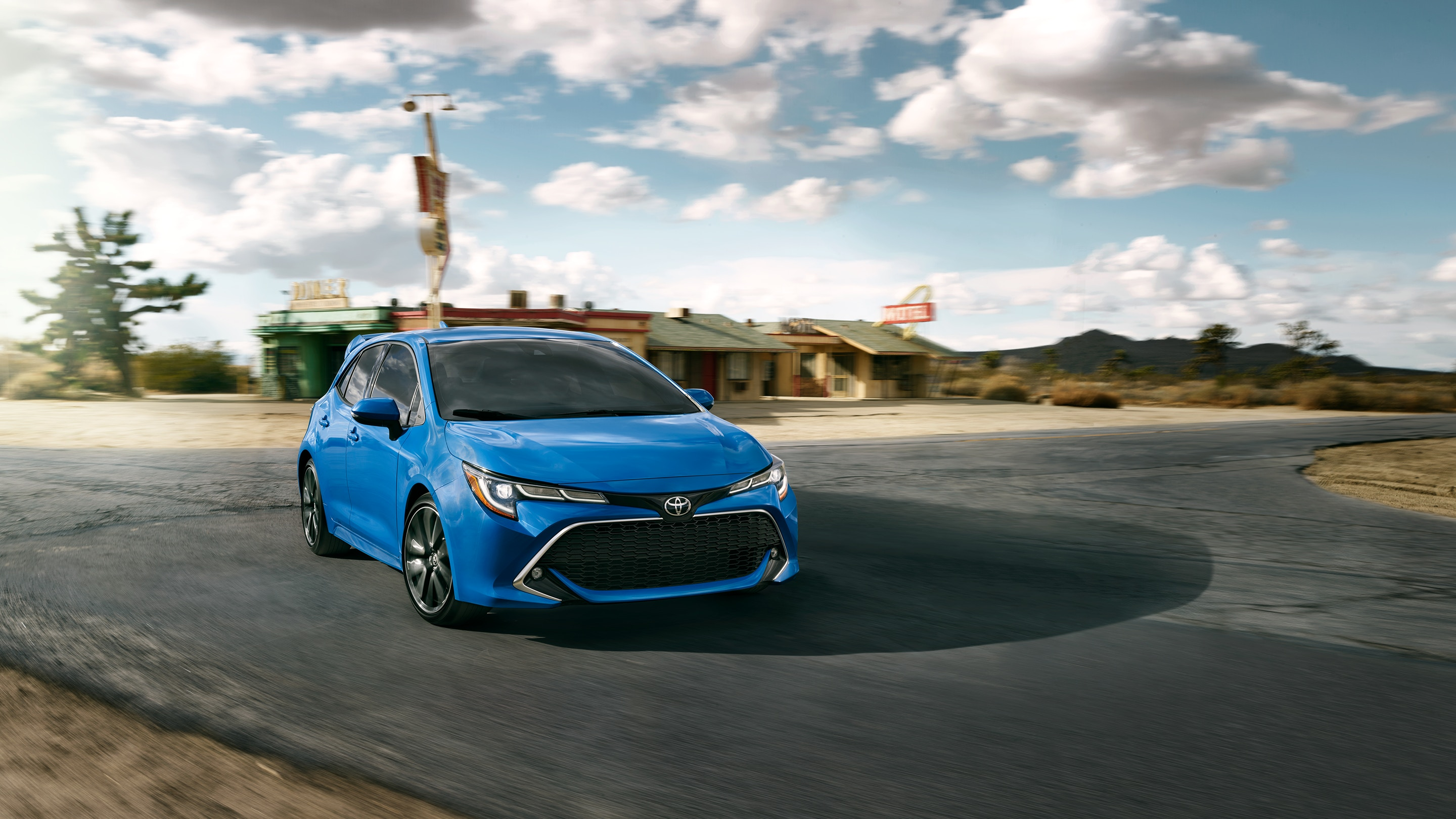 Bright blue Toyota corolla hatchback XSE